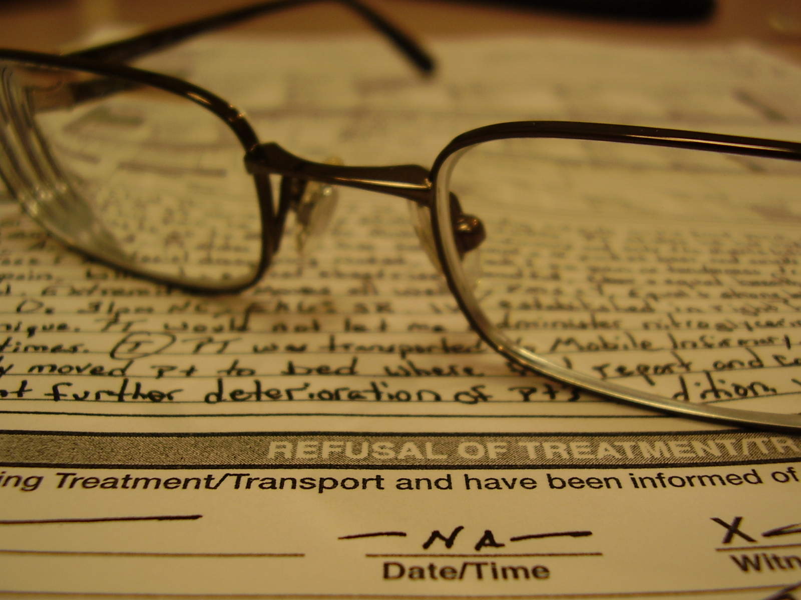 glasses on documents